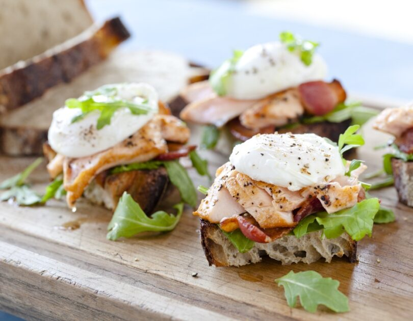 Sautéed Verlasso Salmon with Poached Farm Egg and Applewood Smoked Bacon on Sourdough