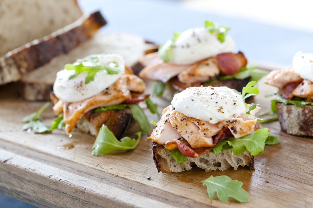 Sautéed Verlasso Salmon with Poached Farm Egg and Applewood Smoked Bacon on Sourdough