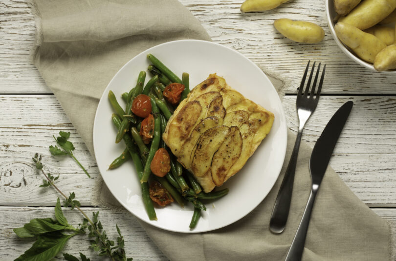 Potato Crusted Trout with Green Beans, Cherry Tomatoes and Garden Herbs