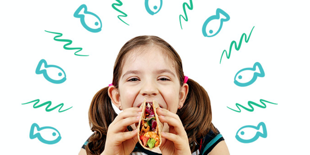 girl eating fish taco for benefits of seafood