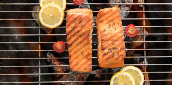 Grilled salmon fillets on the flaming.