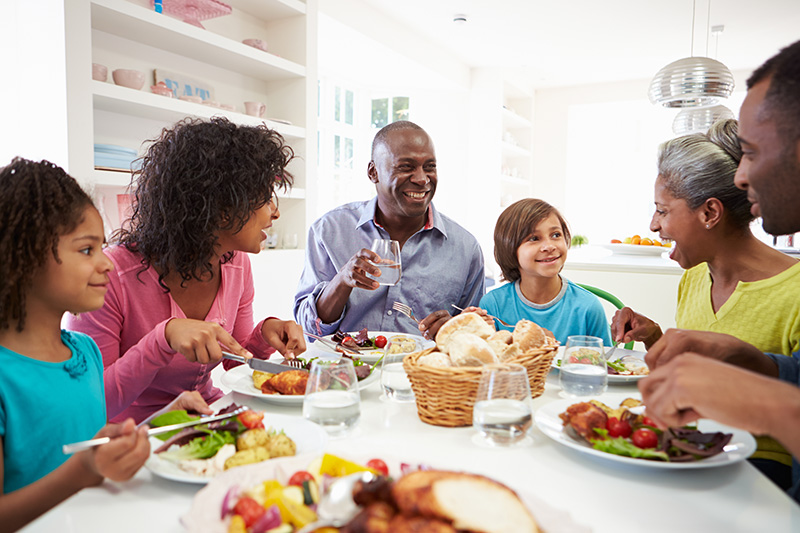 Stock image of a family eating dinner together