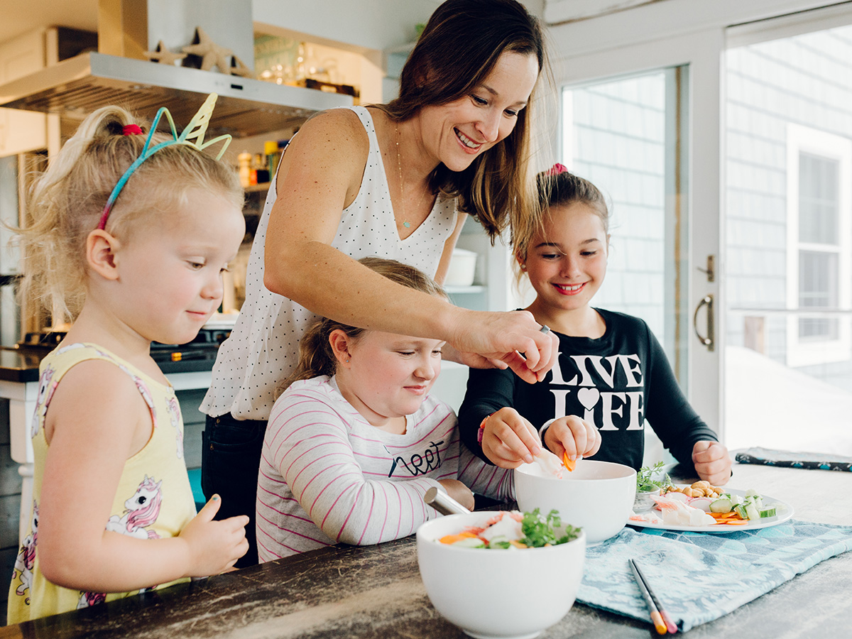 Dana White and her three daughters cooking and eating seafood