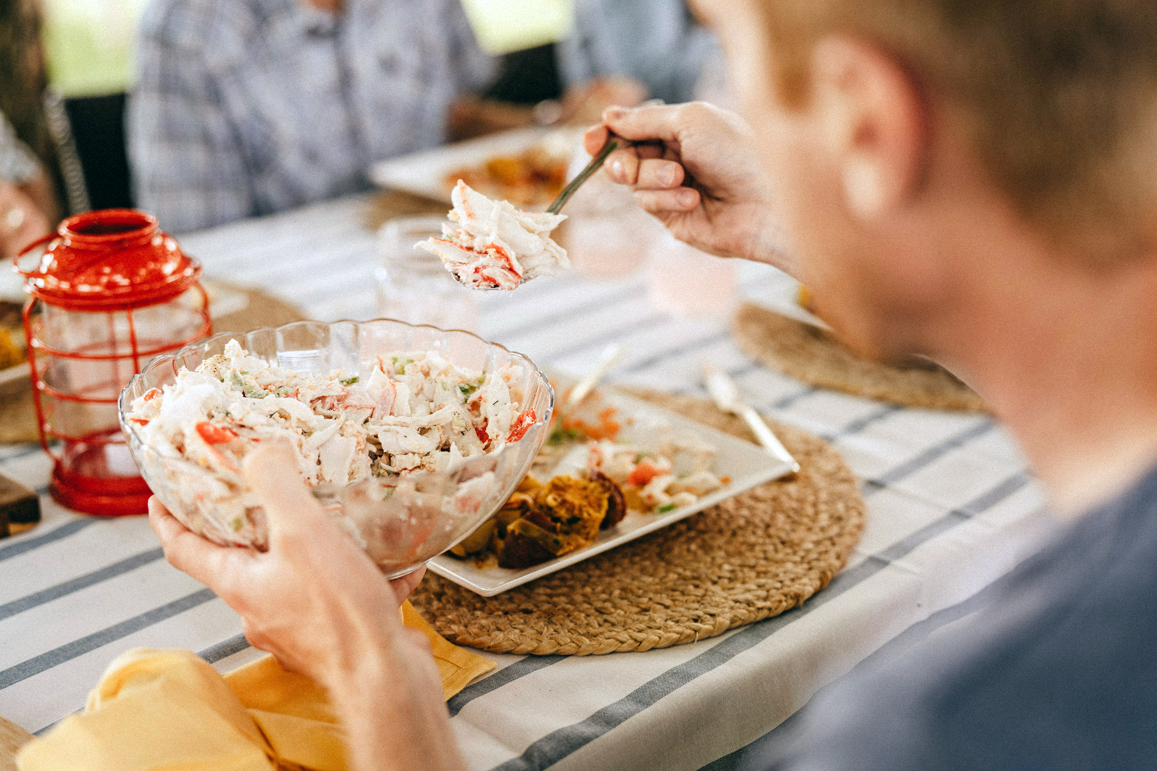 seafood is important for men's health. Man eating surimi salad.